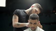 Men's hairstyling and haircutting in a barber shop