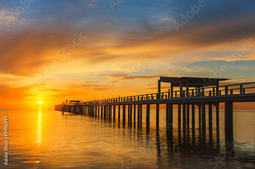 fototapeta na lodówkę Summer, Travel, Vacation and Holiday concept - Wooden pier betwe