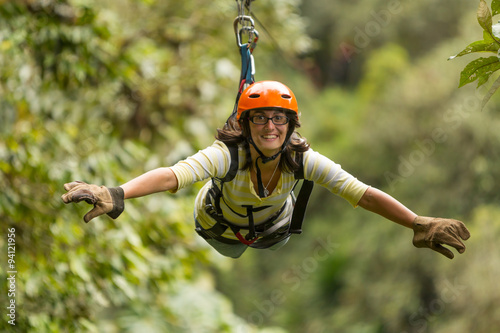Photo zip line adventure woman ecuador tree de banos activity santa wire adrenaline sl