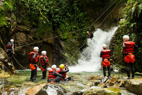 Team Of Mixed People On Canyoning Adventure Wallpaper Mural