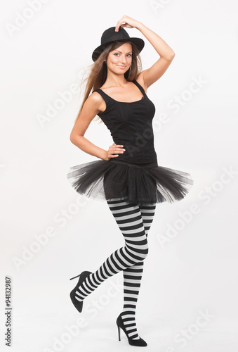 f9b03dd68008c Full length portrait of a smiling girl in black and white striped tights