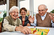 canvas print picture - Elderly couple and daughter, playing board game