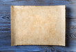 canvas print picture - old parchment on blue wood