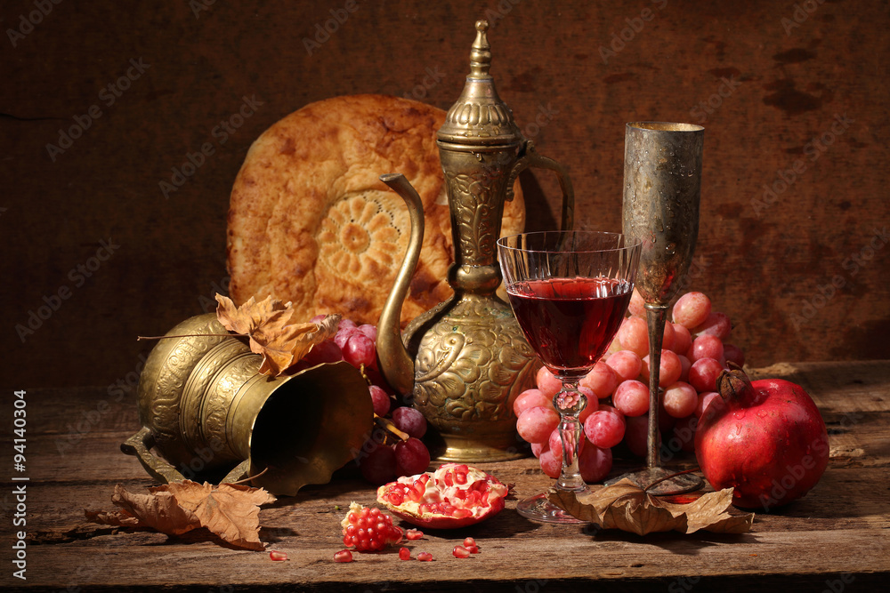 Obraz Still-life in east style with grapes, a pomegranate and a jug fototapeta, plakat