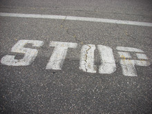 Stop Painted On Parking Lot As...