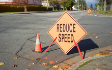 The Image Of Reduce Speed Sign