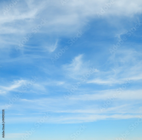 Poster Bleu fluffy clouds in the blue sky
