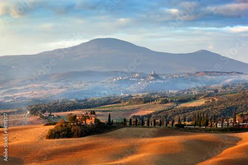 Fotografering  Tuscany landscape at sunrise