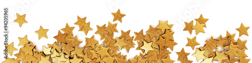 Scattered gold confetti stars - panorama Wallpaper Mural