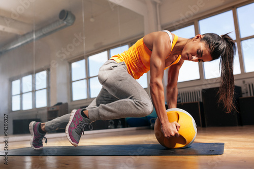 Woman doing intense core workout in gym Canvas Print
