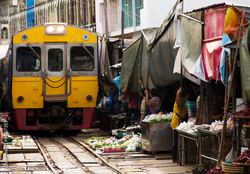 Train drives over the market of Maeklong in thailand
