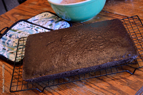Valokuva  Chocolate sheet cake cooling on rack on wooden table