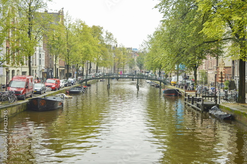 Amsterdam city canal on a cloudy autumn day Wallpaper Mural