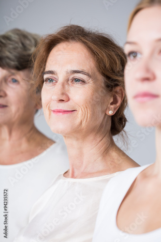 Photo  Three women in white shirts