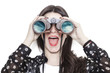 Leinwanddruck Bild Girl portrait looking at cloudscape through binoculars