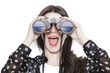 Leinwanddruck Bild Girl portrait looking at sea through binoculars