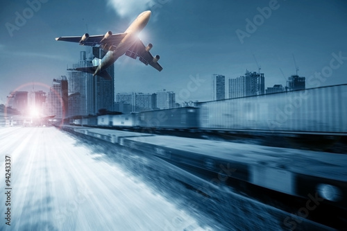 Fotografia, Obraz  container trains ,commercial freight cargo plane flying above use for logistic a