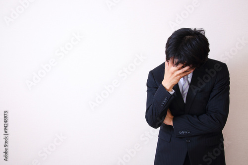 Fotografía  young asian businessman on white background