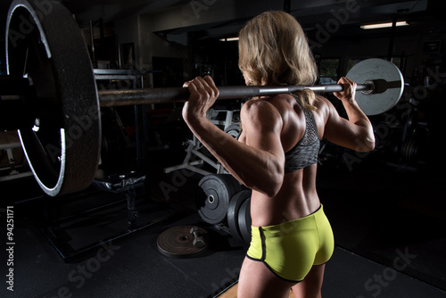 Fotografie, Obraz  Attractive woman at a gym working out