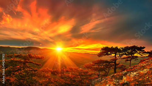 obraz lub plakat mountain sunset and colored sky with clouds