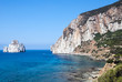 Pan di Zucchero rocks in the sea and Masua's sea stack (Nedida), Sardinia