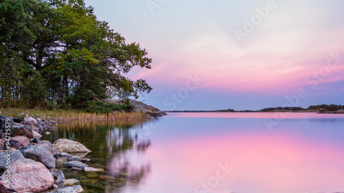 Tuinposter Lichtroze View from the rocky coast of Sweden during sunset
