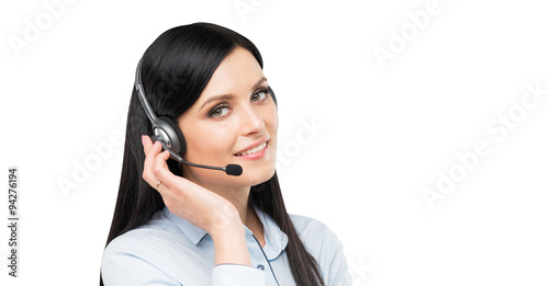 Fotografía  A portrait of smiling cheerful support phone operator in headset