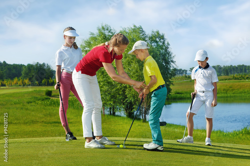 Poster Golf Trainer works with children at golf school
