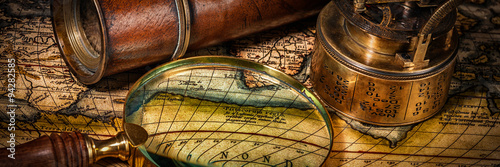 Deurstickers Wereldkaart Old vintage compass on ancient map