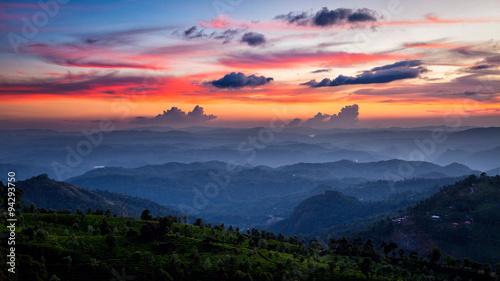 Tuinposter Zwart Sunset in mountains