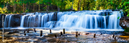 Tuinposter Panoramafoto s Tropical waterfall in jungle with motion blur