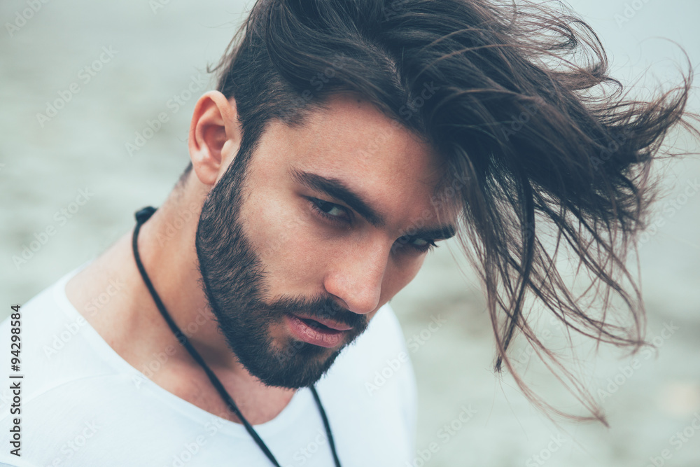 Fototapeta Portrait of a man with beard and modern hairstyle