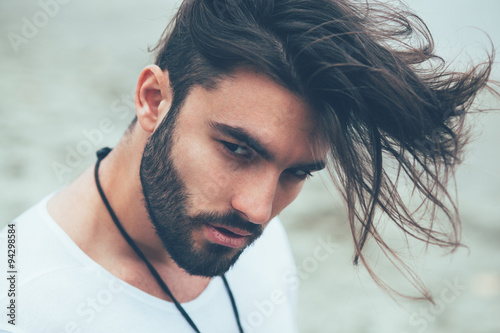 Portrait of a man with beard and modern hairstyle Fotobehang