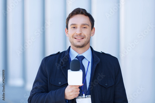 Fotografia, Obraz  Smiling journalist is ready to record reportings.