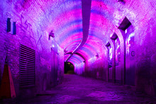 Purple And Pink Illuminated Ganzemarkt Tunnel To Oudegracht In The Old City Centre Of Utrecht, Netherlands