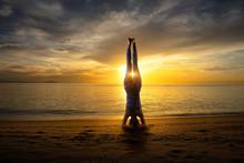 Sunset Yoga Woman Headstand On...