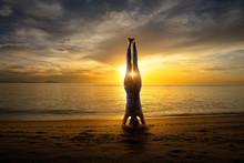 Sunset Yoga Woman Headstand On Sea Coast