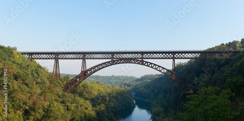 Iron bridge over the river Adda Lecco Italy Canvas Print