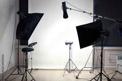 Aluminium Prints Light, shadow Empty photo studio with lighting equipment