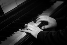 Young Man Playing On Piano, Close Up