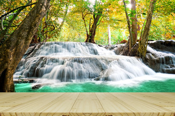 FototapetaPerspective wood window view with beautiful scenic of waterfall