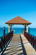Wooden pontoon. Dock with canopy stretching into the sea