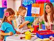 Children with teacher in preschool kindergarten .
