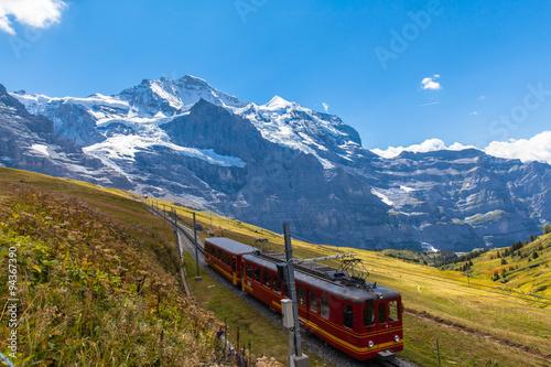Fotobehang Spoorlijn Train running under the Jungfrau