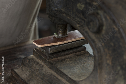 Fotografie, Obraz  Process of making a leather belt with a low depth of field, embossing