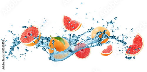 grapefruets in water splash isolated on the white background - 94369576