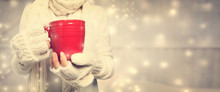 Woman Holding Red Mug In Snowy...