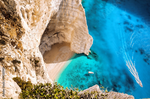 Photo Stands Shipwreck High cliff with boats on Zakynthos island in Greece