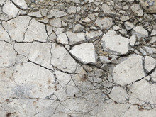 A Grungy Fractured Concrete Pavement For Textural Background