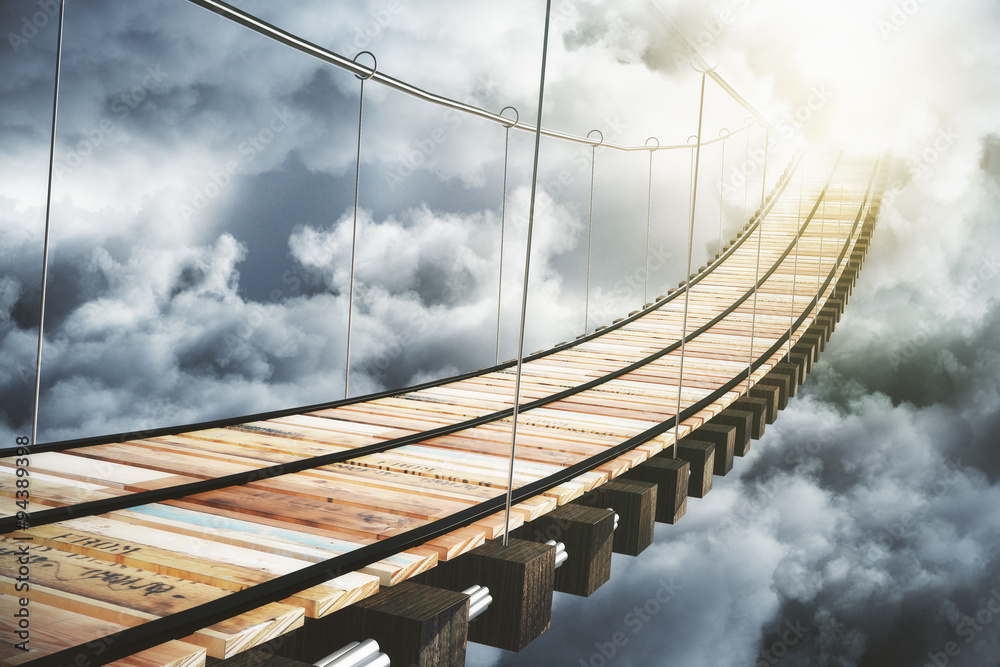 Fototapeta Wooden bridge in the clouds going to sunlight, concept